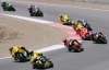 Troy Bayliss and Valentino Rossi lead the MotoGP pack behind Hayden (off camera) through Turn 4 at Laguna.