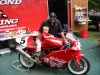 Here, Rob, a DucPond employee tries to explain throttle-steering to his son on Donnie's championship bike.