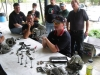 Donnie discusses the differences between the 4V and 2V heads. Members David G., Mike F. and Mark C. look on.