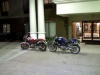 A couple of really dirty bikes in front of the Holiday Inn