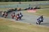 Race 1 turn three freight train coming through on the first lap.